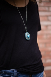 Fashion blogger outfit of the day. black and turquoise jewelry.