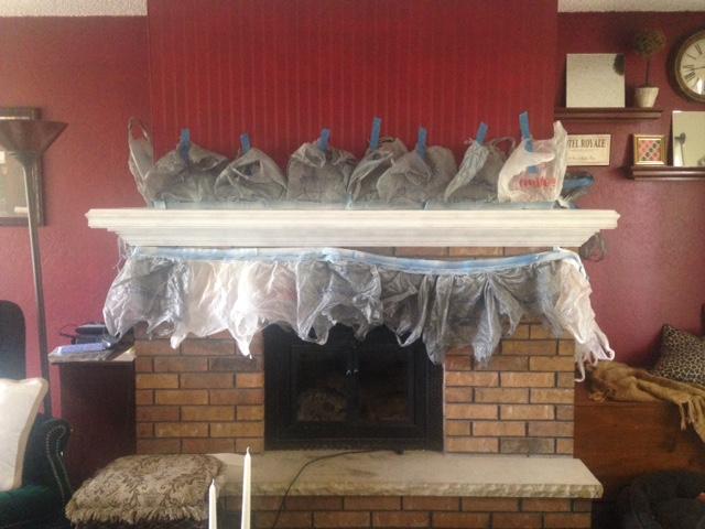 whitewashed brick fireplace and mantle